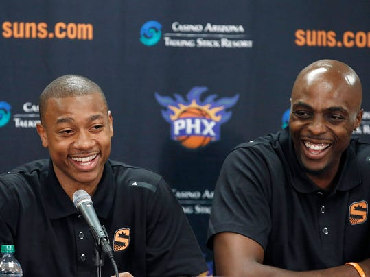 The Phoenix Suns new players Isaiah Thomas, left, and Anthony Tolliver speak as the two basketball players are introduced by the team on Monday, July 21, 2014, in Phoenix. (AP Photo/Ross D. Franklin)