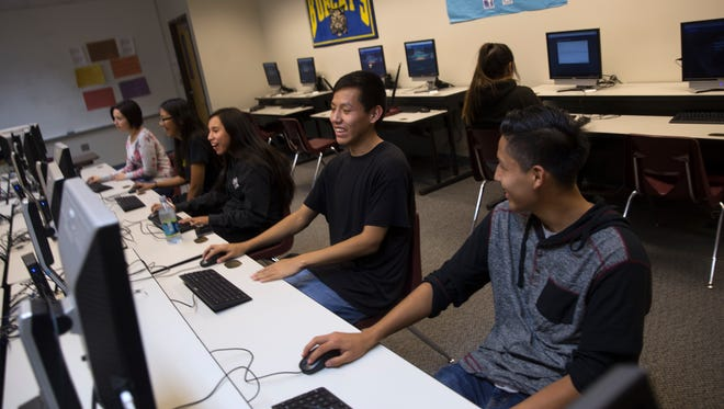 Students use a computer lab during a credit recovery class last week at Charlie Y. Brown High School in Bloomfield.