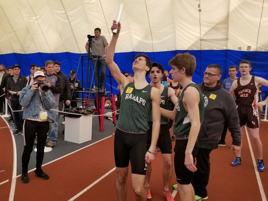 Michael Petrazzuolo points the baton to the sky after Ramapo's boys 4 -x- 400 relay team wins, honoring the memory of teammate, Ben Landel, at the North 1, Group 2 state sectionals in Toms River on Saturday, Feb. 3, 2018.