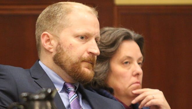 Kelley Hufford with her attorney, Travis Meeks, during her trial last week. She was sentenced to life after being convicted of murder.