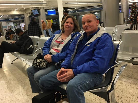Debbie Windish (left) sits at the Wilmington train station on Thursday with her husband Bill. She would consider taking a train to the airport on a direct rail line because otherwise she has to find someone to drive her there.