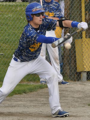 Redford Union's Nick Laidler drops down a bunt during Saturday's game against Thurston.