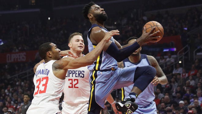 Memphis Grizzlies' Tyreke Evans, right, goes up for a basket past Los Angeles Clippers' Wesley Johnson, left, and Blake Griffin during the first half of an NBA basketball game Tuesday, Jan. 2, 2018, in Los Angeles. (AP Photo/Jae C. Hong)