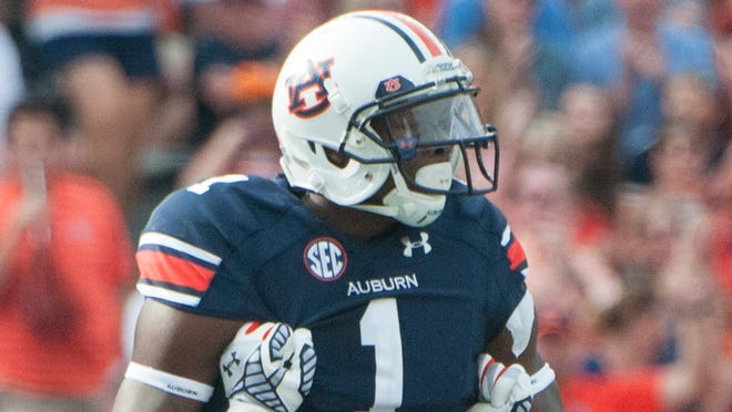 Auburn wide receiver D'haquille Williams is held up by offensive lineman Avery Young after scoring a touchdown against Louisiana Tech.
