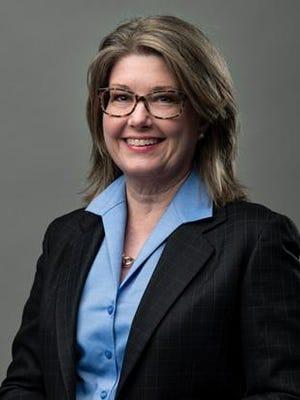 Joan E. Smith