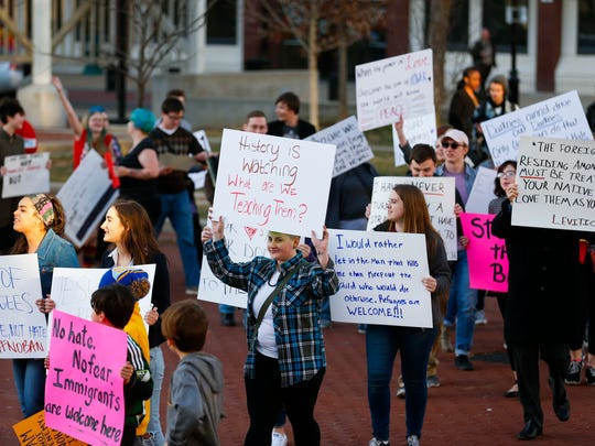 Protestors march around the Park Central Square in Downtown Springfield protesting against President Trump's immigration policies on Monday, Jan. 30, 2017.