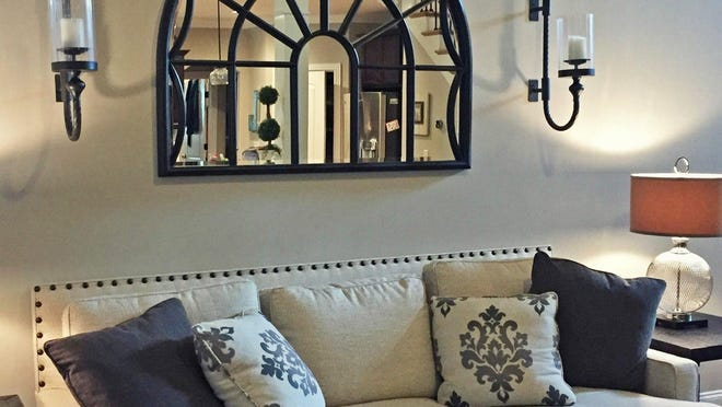 One of my favorite places to hang a mirror is above a couch that is placed up against a wall, and then flank the mirror with sconces.