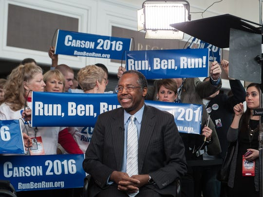 Ben Carson is surrounded by supporters as he waits to be interviewed at the annual Conservative Political Action Conference at National Harbor, Md., on Feb. 26, 2015.
