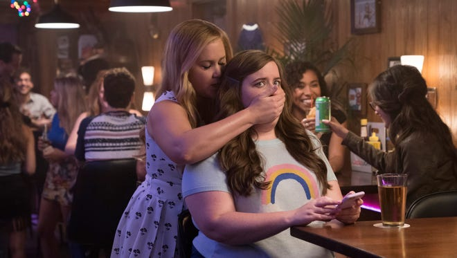 """In """"I Feel Pretty,"""" Renee (Amy Schumer, left) and Vivian (Aidy Bryant) are friends."""