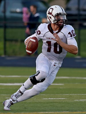 Dowling Catholic quarterback #10 Ryan Boyle made quick change of direction as he ran against Urbandale in a football game played at Urbandale High School on Friday night Sept. 5, 2014.