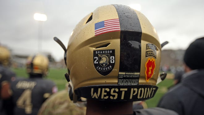 An Army player wears a helmet decal honoring defensive back Brandon Jackson, who died Sept. 11 in a single-car accident.