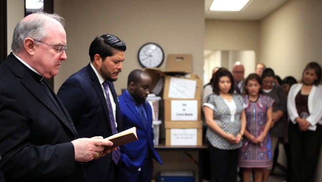 The Most Rev. Michael Mulvey, bishop of the diocese of Corpus Christi, recites a prayer before blessing the Nueces County District Attorney's offices at the Nueces County Courthouse on Tuesday, March 21, 2017.