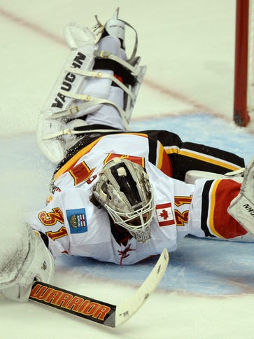 Calgary Flames goalie Karri Ramo is unable to make