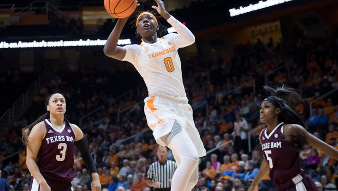 Tennessee freshman Rennia Davis set new personal highs with 33 points and 14 rebounds Thursday night. She also had a key steal with nine seconds left to help the Lady Vols beat Arkansas