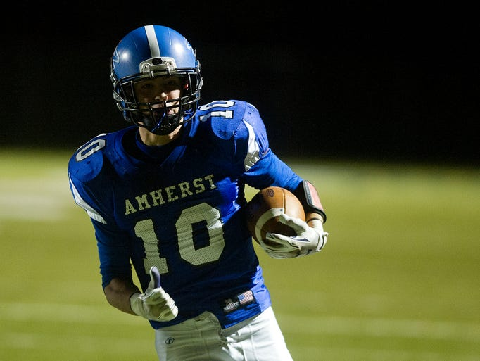 Amherst's Brandon Piotrowski carries the ball during