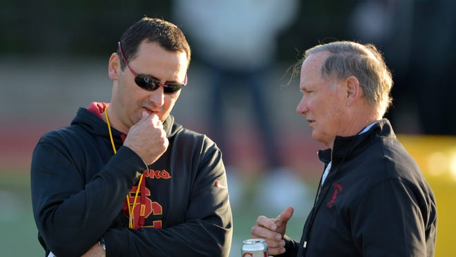 Southern California Trojans coach Steve Sarkisian (left) and athletic director Pat Haden at spring practice at Cromwell Field on March 3, 2015.