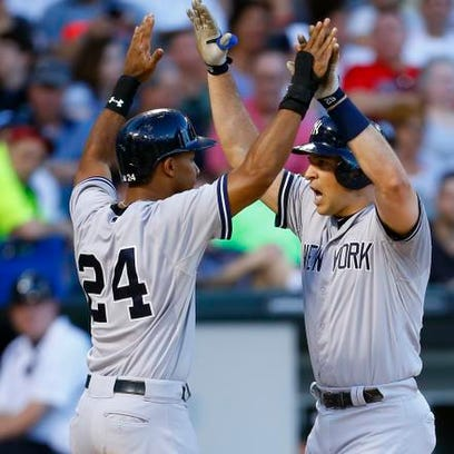 Yankees' Mark Teixeira, right, is congratulated by