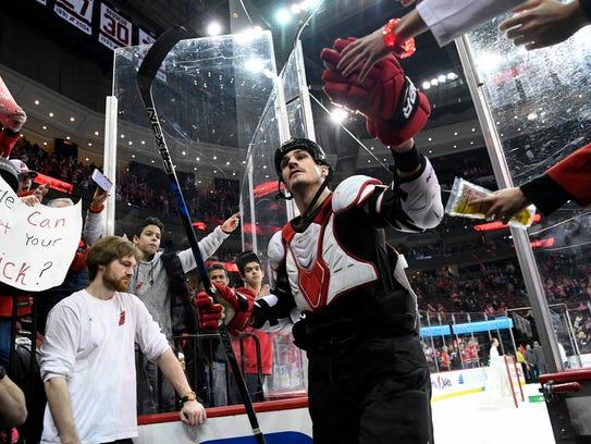New Jersey Devils center Brian Boyle high-fives fans