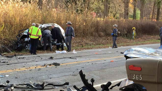 Police investigate the scene of a fatal head-on collision Friday on Route 22 in Southeast. Two people died.