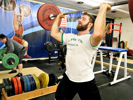 Greg Smith, right, of Shrewsbury, and Deborah Duckworth, left, of Fawn Township, lift during open gym Thursday at McKenna's Gym in Fawn Grove. The gym is moving to a new location in Stewartstown.