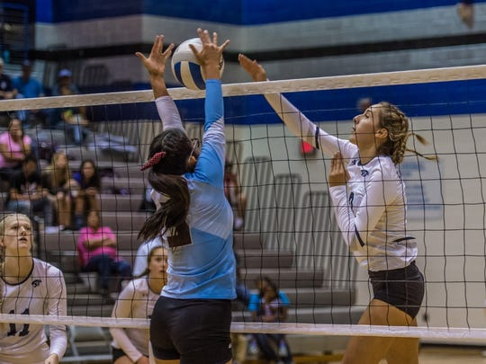 Piedra Vista's Bebe Jaquez records a kill against Ganado, Ariz., during the championship match of the Piedra Vista Invitational on Saturday at the Jerry A. Conner Fieldhouse in Farmington.