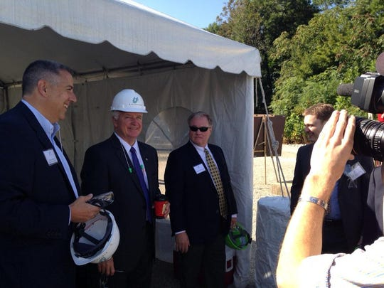 Then-Gov. Tom Corbett, center, and state Sen. Scott Wagner, right, begin a tour at Glatfelter's Spring Grove mill in September 2014. Corbett visited the facility to announce a $5 million Economic Growth Initiative Grant and a $3-million Alternative and Clean Energy Grant to help the mill convert to natural gas for its boilers.