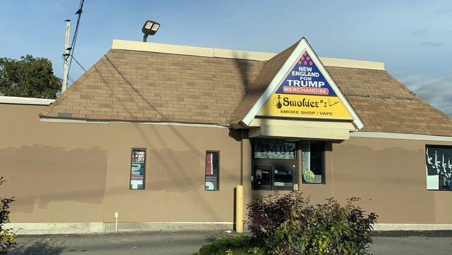 The New England Trump Store on Route 6 in Somerset can be seen here Sunday morning, after the graffitti was painted over.