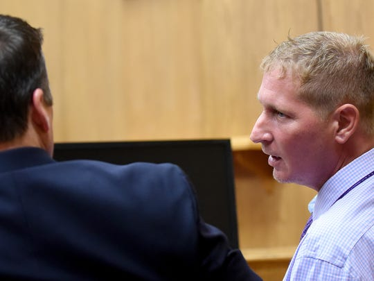 Defendant Thomas Kosto (right) leans over to attorney Rob Calesaric during the prosecutions opening statement in court on Tuesday, June 27, 2017. Kostois charged with involuntary manslaughter, corrupting another with drugs, tampering with evidence and possession of heroin in relation to Chad Baker's overdose death on May 29, 2015.