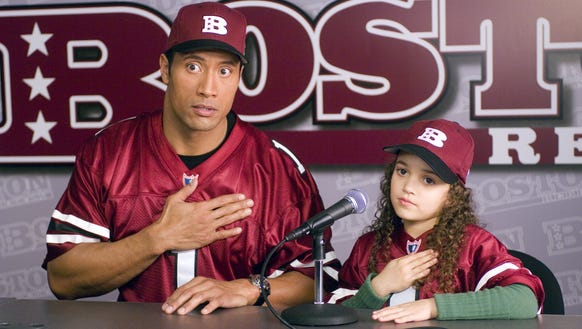 "Dwayne Johnson plays the quarterback dad and Madison Pettis is his daughter in ""The Game Plan."""