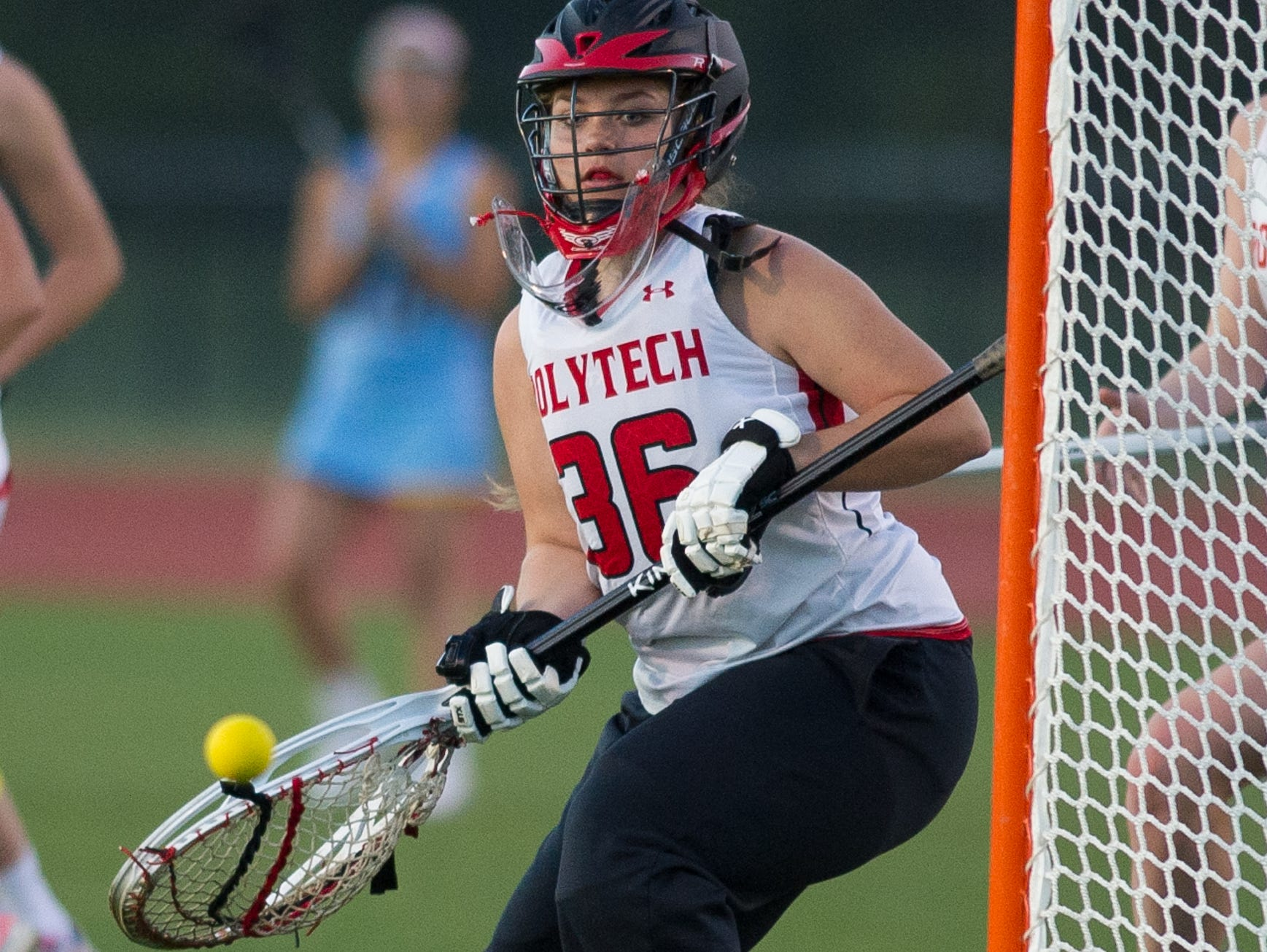 Polytech's goalie Shannon Stephan (36) watches as a shot from Cape Henlopen misses the goal.