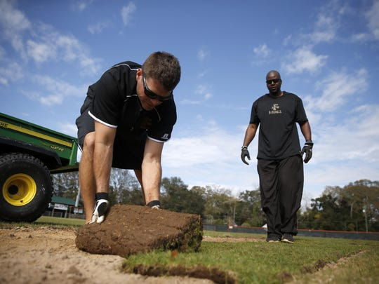 FAMU baseball assistant coaches Bryan Henry, left,