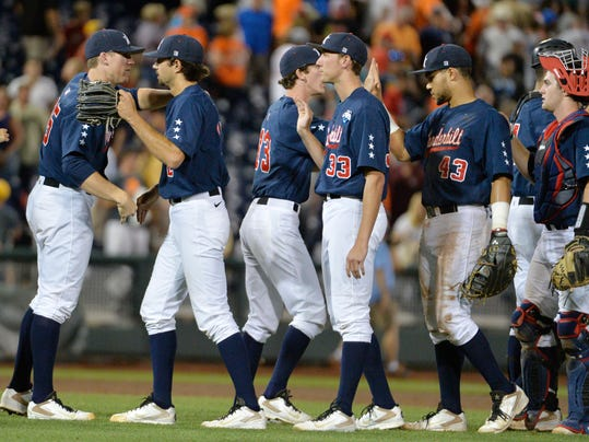 Vanderbilt coach Tim Corbin, left, celebrates with his players after Vanderbilt defeated Virginia 9-8 in the opening game of the best-of-three NCAA baseball College World Series finals in Omaha, Neb., Monday, June 23, 2014. (AP Photo/Ted Kirk)