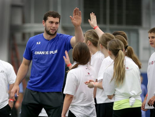 Indianapolis Colts Andrew Luck and Riley Hospital for Children at Indiana Health welcomed over 500 students from around Indiana to their 8-week health, fitness and nutritional program Change the Play Friday morning at the Colts Complex. Here Luck exchanges high-fives with the students.