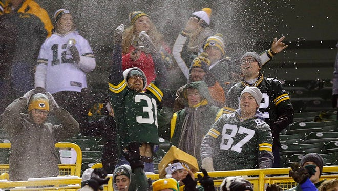 Fans celebrate the Green Bay Packers' 38-10 win over the Seattle Seahawks.