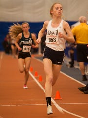 Howell's Niamh Hayes takes an easy first in the Girls 3200 Meter Run at NJSIAA Girls Track Meet of Champion at Bennett Complex in Toms River on February 25, 2017.