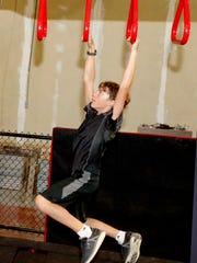 Caleb Brown, 12, goes through part of an obstacle course during the Fortified Warrior Class, on Tuesday, Sept. 19, 2017.