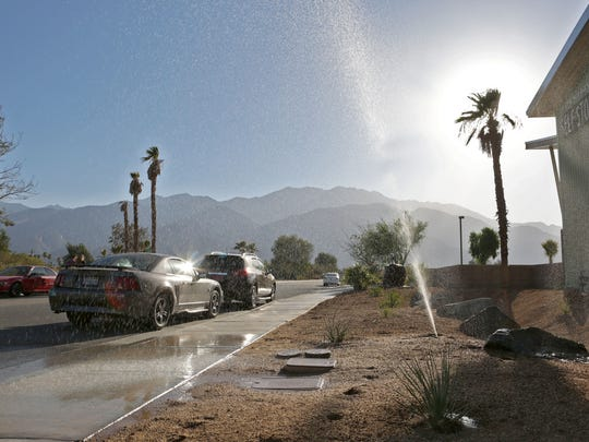 A broken sprinkler sends water in all directions on June 10 in Palm Springs. The city has made progress in conserving water as of late, saying it reduced its water use by nearly 500,000 gallons in the past six months.