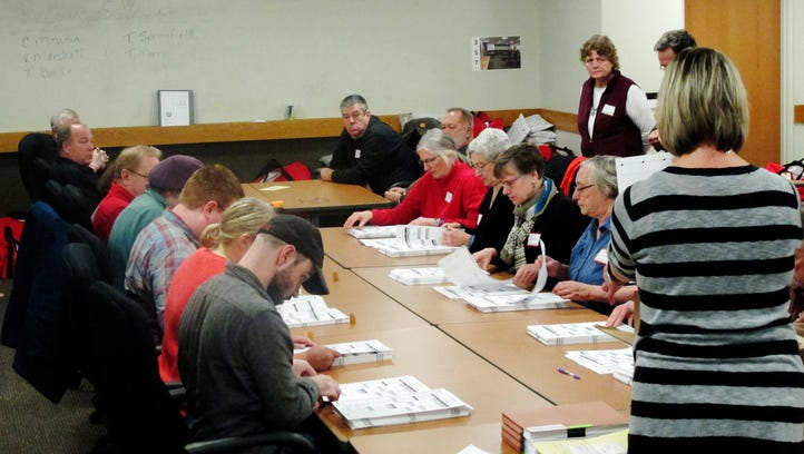 Ballots from the town of Middleton, Wis., are placed