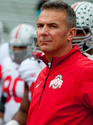 Coach Urban Meyer and Ohio State face Michigan this week.