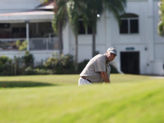 Jim Kellogg chips onto a green at the Fort Myers Country Club in Fort Myers.