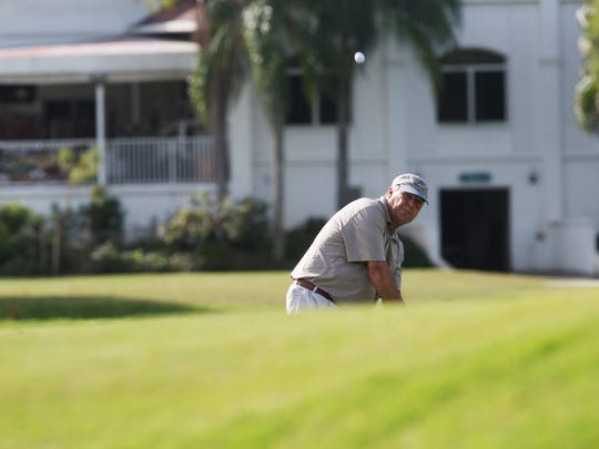 Jim Kellogg chips onto a green at the Fort Myers Country Club in Fort Myers on Wednesday.