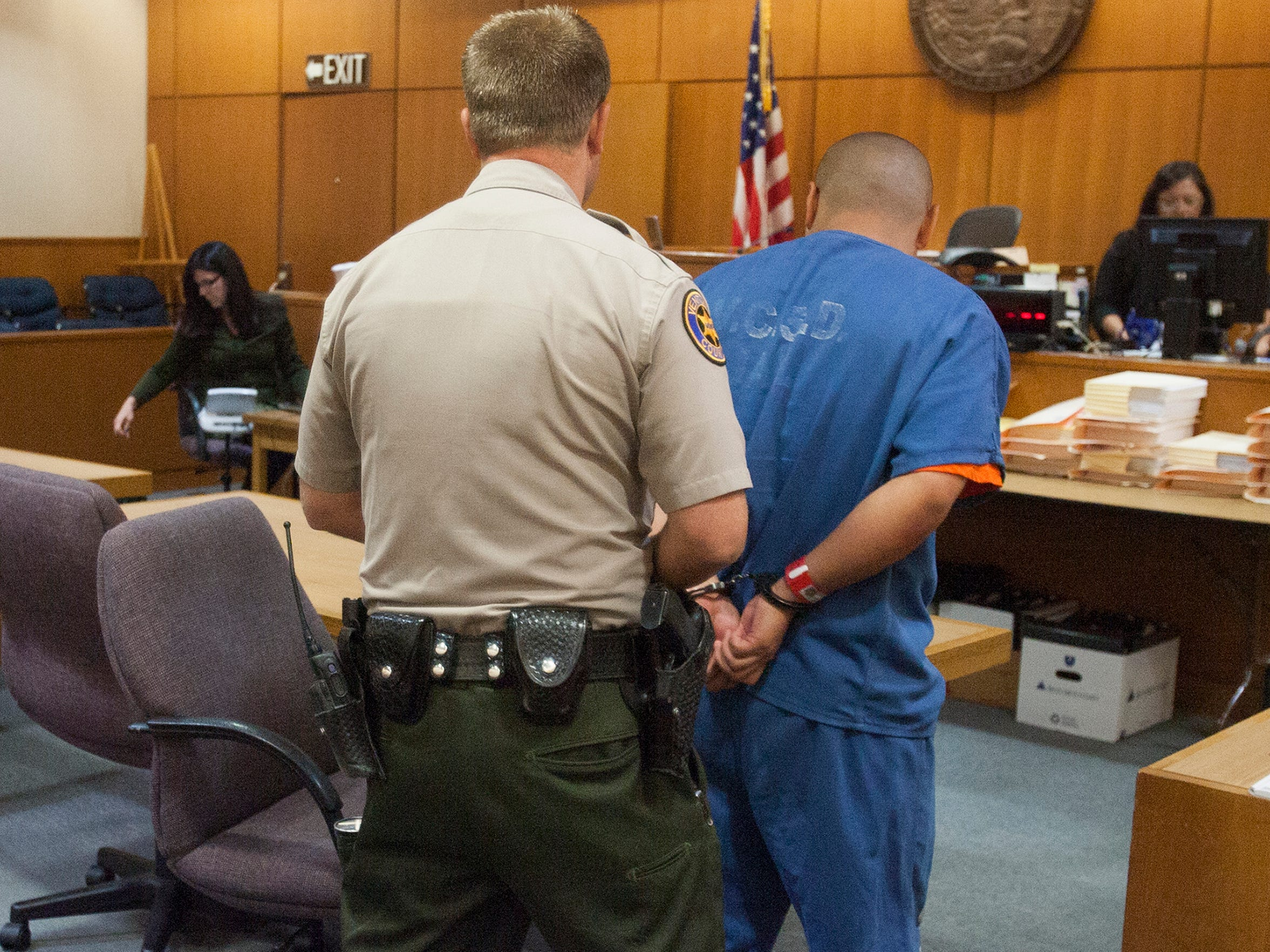 Joseph Salas, right, is handcuffed Aug. 21 to be transported back to the Ventura County Jail after a hearing in Ventura County Superior Court. Salas, 18, of Port Hueneme, was challenging his inclusion on an injunction against the Southside Chiques street gang in Oxnard. The judge in the case decided Salas could be kept on the gang injunction.