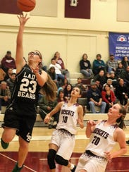 Cloudcroft's Kaylee Hickman, left, tries to make a