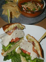 You can't go wrong with a turkey sandwich on homemade focaccia bread – a creation that adds bacon, lettuce, tomato, red onion, avocado and basil mayo. In the background is homemade tortilla soup and traditional grilled Mexican street corn.