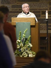 Fr. Tim Baltes led a prayer service in memory of Samuel Traut on Wednesday at the St. Francis Xavier Catholic Church.