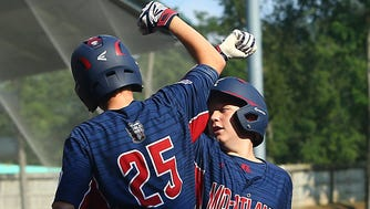 Anthony Abbonizio congratulates R.J. Vashey on his third inning home run for Holbrook Little League in the Little League World Series on Monday.