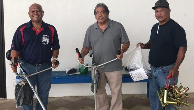 The Guam Islanders Softball Association recently donated supplies to the Department of Parks and Recreation. Pictured, from left are GISA president Pete Torres, DPR Deputy Director John Taitano and DPR staff member Marky Telui from DPR. The donation included two bush cutters, bush cutting supplies and a canopy.