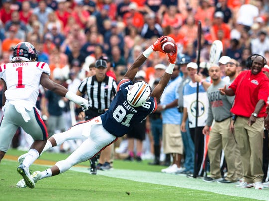 Auburn wide receiver Darius Slayton (81) catches a pass as Ole Miss defensive back D.D. Bowie (1) guards him during the NCAA football game between Auburn and Ole Miss on Saturday, Oct. 7, 2017, in Auburn, Ala.