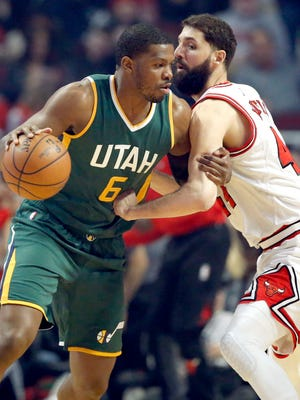 Utah Jazz guard/forward Joe Johnson, left, drives against Chicago Bulls forward Nikola Mirotic during the first half on Saturday night.