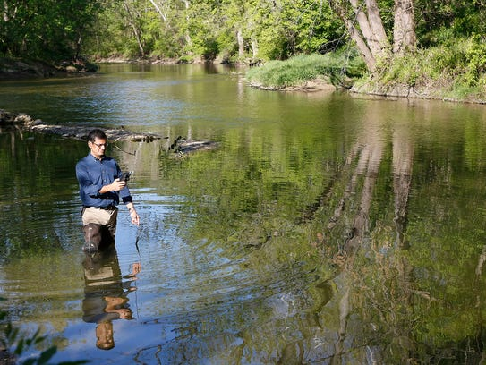 Indrajeet Chaubey, a professor of ecohydrology, tests